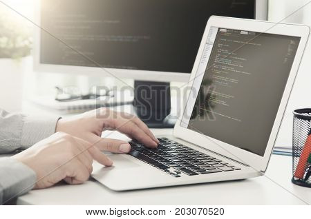 Programmer working busy software developing in company office. programmer code computer program technology office software hands on laptop concept