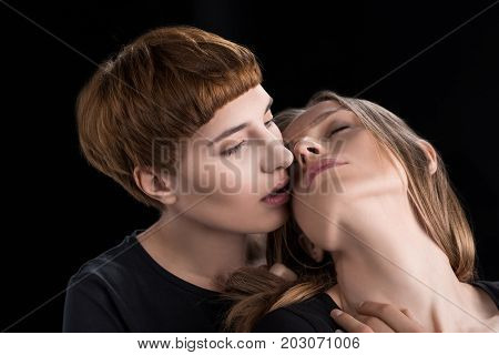 Lesbian Couple Leaning In For Kiss