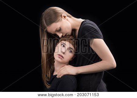 Woman Hugging Upset Girlfriend