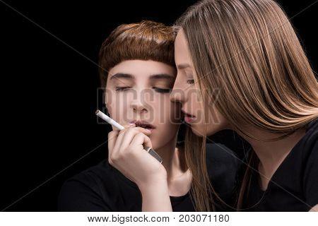 Woman Touching Cheeks With Girlfriend