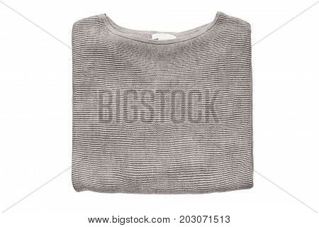 Beige basic pullover folded on white background