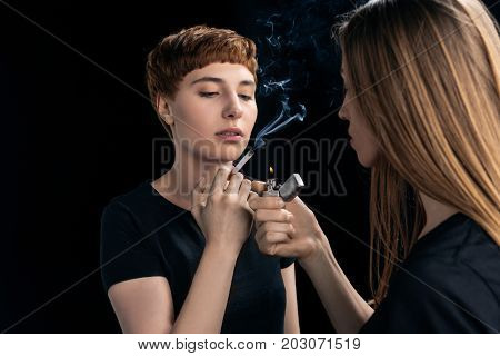 Young Woman Lighting Cigarette