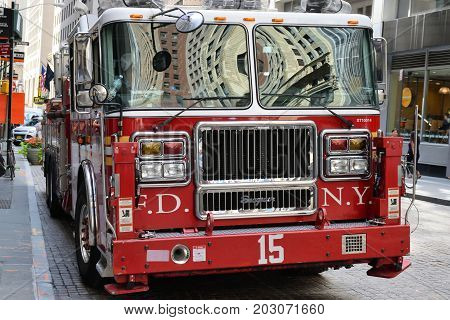 NEW YORK CITY USA - AUG. 23 : FDNY fire truck parked on the street in Manhattan on August 23 2017 in New York City NY. Manhattan is the most densely populated borough of New York City.