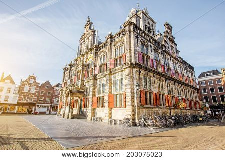 View on the Town hall and beautiful buildings on the central square during the sunny morning in Delft city, Netherland