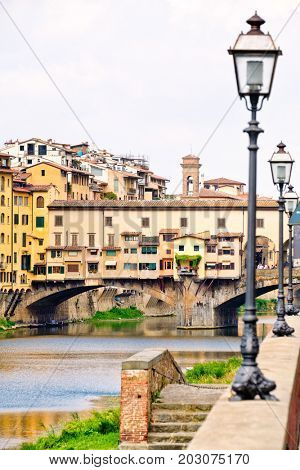 The Ponte Vecchio over the river Arno in Florence, Italy poster