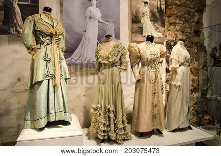 Riga, Latvia - July 5, 2012 - Retro spring, summer, autumn dresses of early 20th century for everyday, casual, walk. Fashionable luxury collection. Closely view of historic costumes for design, ideas.