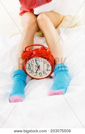 Woman In Pajamas Wearing Furry Warm Socks