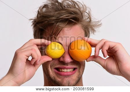 Man With Orange And Lemon Instead Of Eyes In Hands