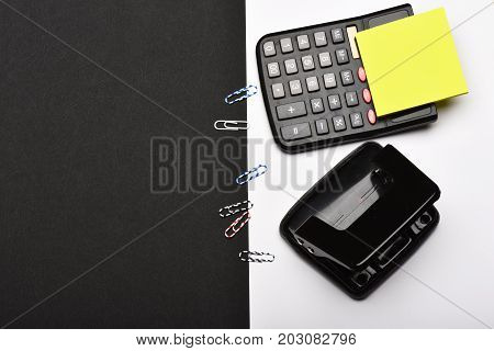 Business And Work Concept: Stationery And Calculator On White Background