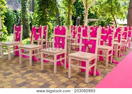Wedding Chairs On Each Side Of Archway With Pink Cloth. Place For Wedding Ceremony Decorated In Pink