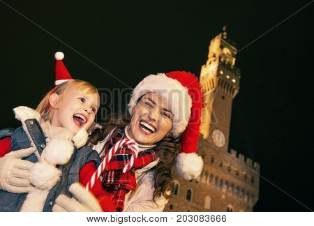 Mother And Child Showing Christmas Candy Cane In Florence