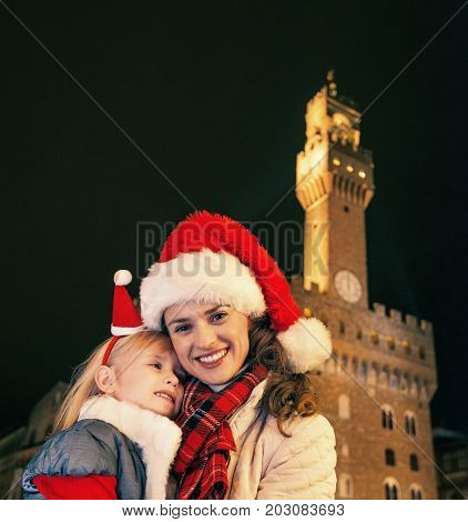 Mother And Child In Christmas Hats Near Palazzo Vecchio, Italy