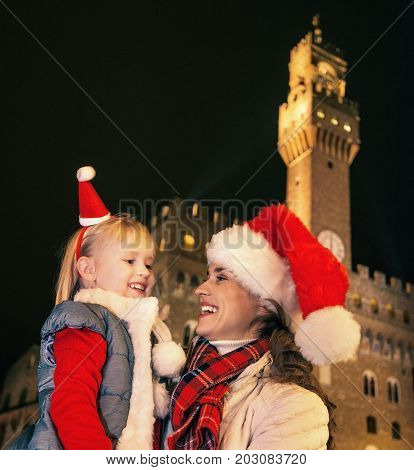 Mother And Child In Christmas Hats Looking At Each Other, Italy