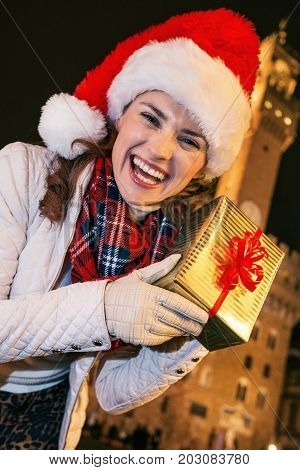 Happy Woman Near Palazzo Vecchio Showing Christmas Present Box
