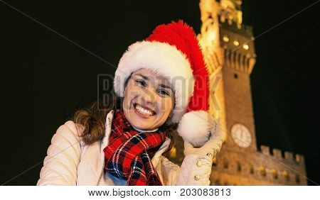 Woman In Christmas Hat Near Palazzo Vecchio In Florence, Italy