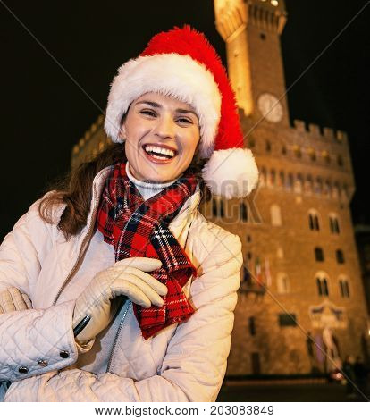Woman In Christmas Hat Against Palazzo Vecchio In Florence