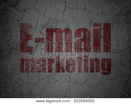 Advertising concept: Red E-mail Marketing on grunge textured concrete wall background