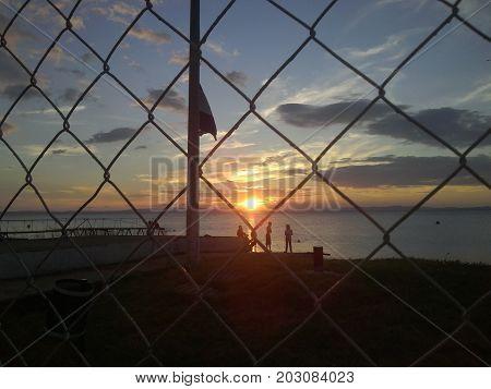 Four men watching a Beautiful Sunset at Isla Ometepe - Ometep Island - Nicaragua