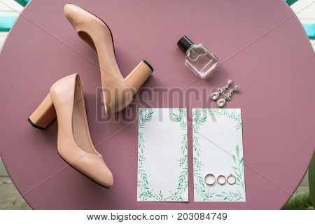 Wedding Accessories, Selective Focus. Bridal Shoes, Jewelry, Perfume Bottle, Wedding Rings And Luxur