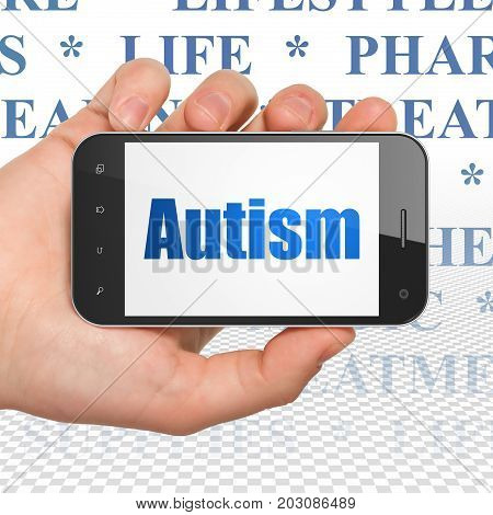 Medicine concept: Hand Holding Smartphone with  blue text Autism on display,  Tag Cloud background, 3D rendering