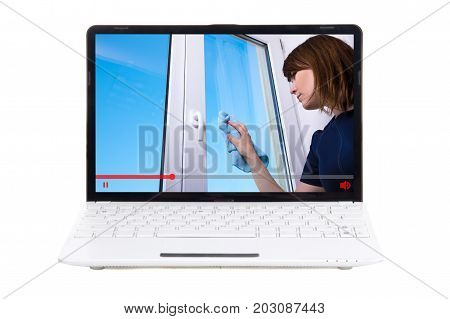 Video Blog And Tutorial Concept - Young Woman Showing How To Clean Windows On Laptop Screen
