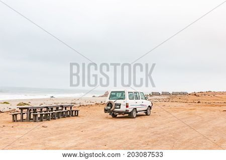 CAPE CROSS NAMIBIA - JUNE 29 2017: A picnic spot with camping sites in the back near the seal colony at Cape Cross on the Skeleton Coast of Namibia