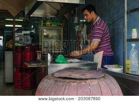 A Man Cooking At Local Restaurant