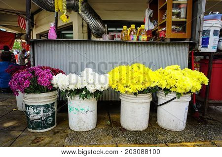 Selling Flowers At Street Market