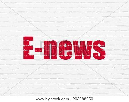 News concept: Painted red text E-news on White Brick wall background
