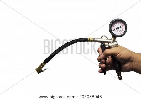 Hand holding an inflator gauge tools Hand of mechanic man checking air pressure gauge of car tyre on white background with copy space for writing text decoration Automotive parts concept.
