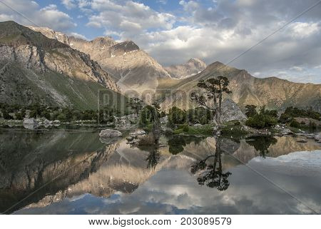 Tranquil Kulikalon lake as mirrow in wich trees mountain and sky reflect.