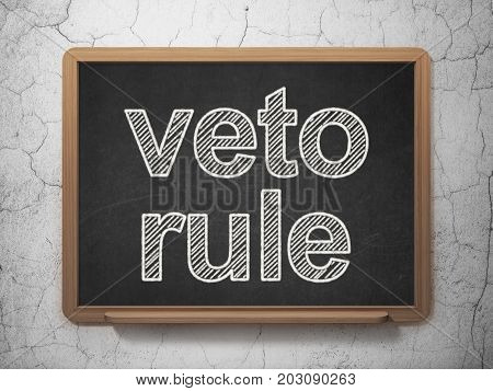 Political concept: text Veto Rule on Black chalkboard on grunge wall background, 3D rendering