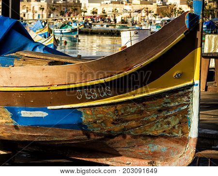 Traditional Maltese fishing ragged shabby boat, luzzu