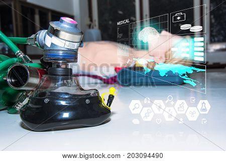 oxygen mask and demand valve on desk near dummy model cpr