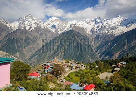 Kalpa village and Kinnaur Kailash sacred peak at sunrise view. Himachal Pradesh, India.