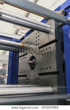 Part of extrusion manufacturing line - extruder, close up view