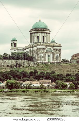 Beautiful basilica and Danube river in Esztergom Hungary. Cultural heritage. Travel destination. Place of worship. Religious architecture. Old photo filter.