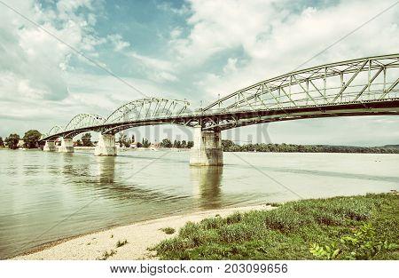 Maria Valeria bridge joins Esztergom in Hungary and Sturovo in Slovak republic across the Danube river. Transportation theme. Architectural scene. Old photo filter.