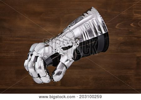 Medieval metal glove, detail of part of ancient armor, detail of war