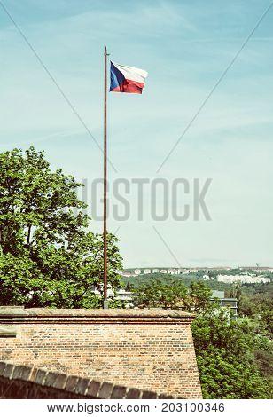 Czech flag on the Spilberk castle Brno southern Moravia Czech republic. State symbol. Old photo filter.