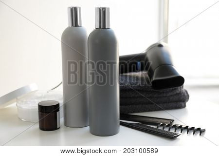 Composition with set for hair care on bath table