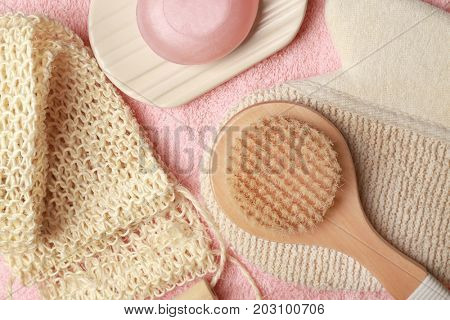 Bath accessories and soap on fabric background