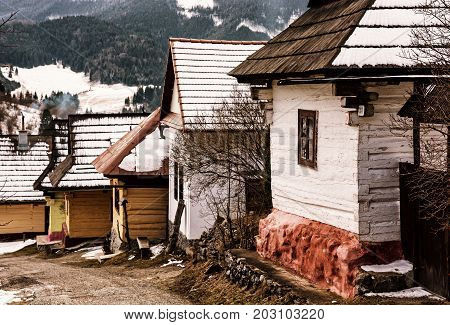Beautiful wooden houses in Vlkolinec village Slovak republic Unesco. Cultural heritage. Travel destination. Yellow photo filter.
