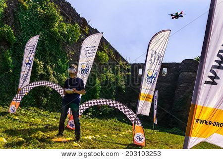 Uzhgorod Ukraine - September 2 2017: The competitor controls his drone on the track during the Eastern European Cup 2017 on drone racing.