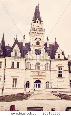 Beautiful Budmerice castle in Slovak republic. Architectural theme. Cultural heritage. Vertical composition. Travel destination. Old photo filter.