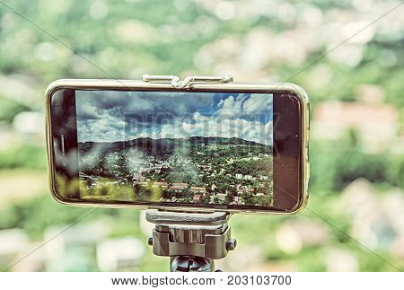 Smart phone mobile photography of old mining town Banska Stiavnica in Slovak republic. Technology and travelling. Beauty photo filter.