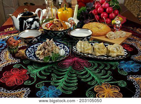 food set Central Asian cuisine - plov lagmansherbet manti