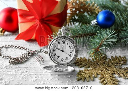Watch and decorations on table. Christmas countdown concept