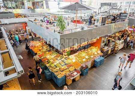 ROTTERDAM, NETHERLANDS - August 06, 2017: Interior of the innovative Market hall building in Rotterdam. This building has apartments and offices and was designed by architectural firm MVRDV