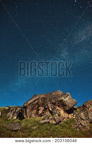 A large rock in the Caucasus against the Milky Way